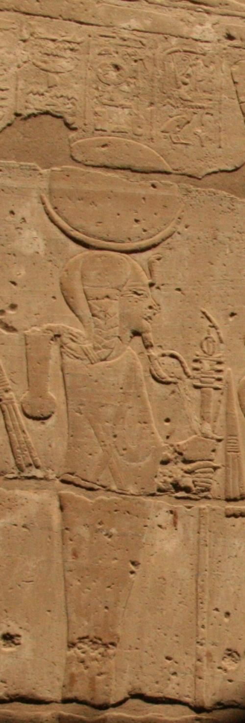 Khonsu with side lock and lunar head-dress. Relief from the funerary temple of Seti I in Dra Abu el-Naga. XIX Dynasty. Photo: Mª Rosa Valdesogo Martín.