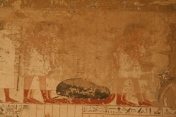 Tekenu wrapped in a shroud and in foetal position over a sledge. Painting from the tomb of Ramose in Gourna.XVIII Dynasty. Photo: Mª Rosa Valdesogo Martín.