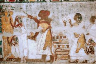 Opening of the Mouth ceremony. The image shows the two mourners, the priests and the table with all the tools utilised, included the foreleg of an ox. Painting from the tomb of Khonsu in Gourna. XIX Dynasty. Photo: www.osirisnet.net