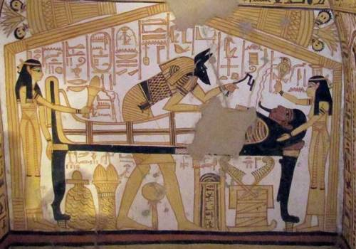 Anubis, Isis and Nephtys in the Opening of the Mouth rite. Painting from the tomb of Nakhtamon in Deir el-Medina. XIX Dynasty. Photo: www.osirisnet.net