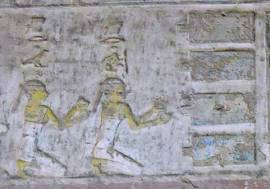 The two Drty (two kites), offering nw vases to the four pools. Relief from the tomb of Pahery in el-Kab. XVIII Dynasty. Photo: www.osirisnet.net