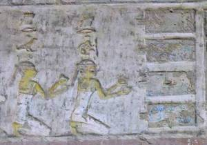 The two Drty (two kites), offering nw vases to the four pools. Relief from the tomb of Pahery in el-Kab. XVIII Dynasty. Ancient Egypt