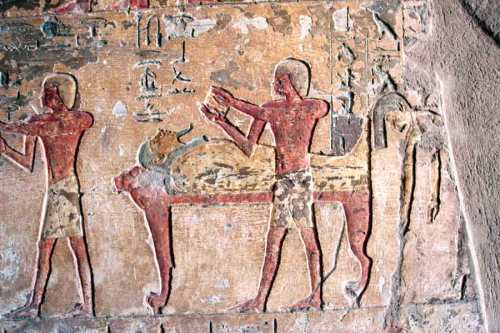 Opening of the Mouth ceremony; on the right the mourning is making the nwn gesture forwards the mummy. Tombof Renni in el-Kab. XVIII Dynasty. Photo: www.osirisnet.net