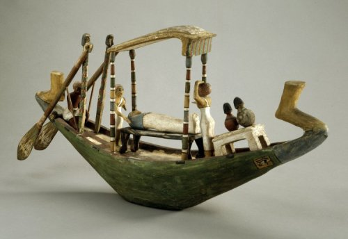 wood model of a boat with mummy and mourners. British Museum EA9524. XII Dynasty. Ancient Egypt